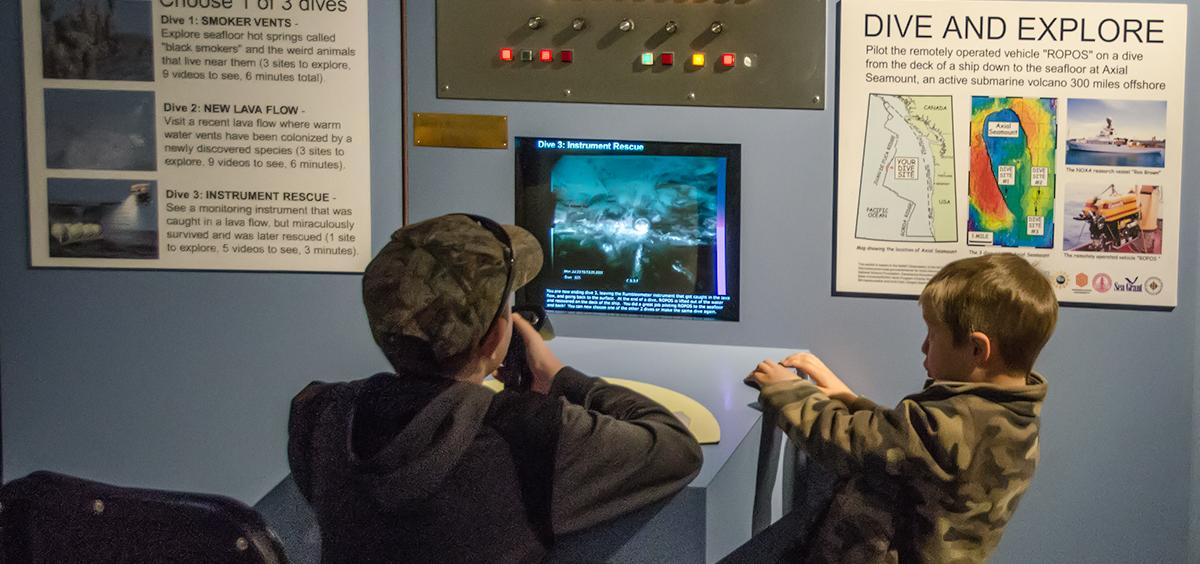 Young boys explore the deep sea with our video exhibit