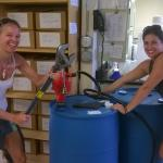 Katie Shulzitski and Maria Daughtry prep the ethanol pump and barrel.