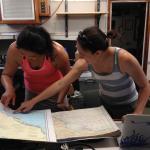 Jessica Luo (RSMAS) and Dr. Diane Adams (Rutgers) examine nautical charts.