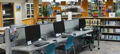 A row of computers on desks at Guinn Library at Hatfield Marine Science Center