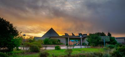 Entrance to the Hatfield Visitor Center with large colorful sky in background.