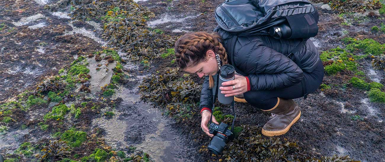 student photographing tide pool
